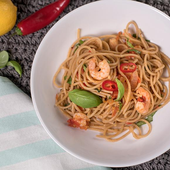 The tomato-based sauce in our chilli prawn pasta lowers the fat and calories